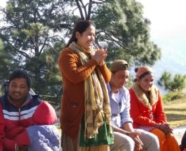 Manju Bhatta leading a discussion in the field