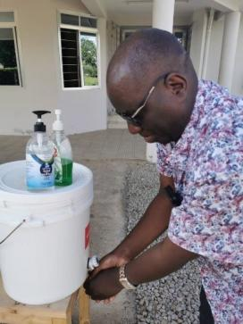 Alex Njahani, our Forest Management and Value Chain Development Expert, washing his hands at the office