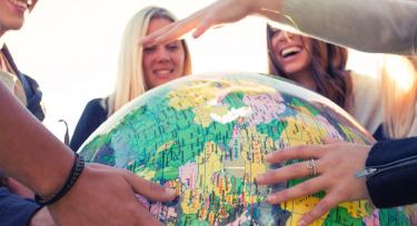 People holding a globe